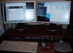 Photograph of my two new widescreen monitors.